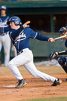 Ryan Bostian #20 of the Catawba Indians follows through on his swing versus the Shippensburg Red Raiders on February 14, 2010 in Salisbury, North Carolina.  Photo by Brian Westerholt / Four Seam Images