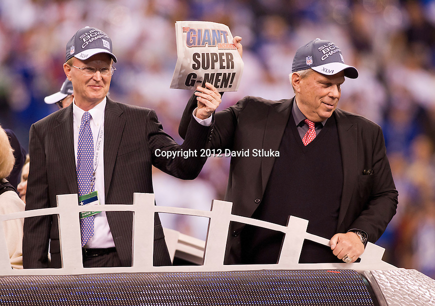 New York Giants President and Chief Executive Officer John Mara, left, and Chairman and Executive Vice President Steve Tisch celebrate a victory over the New England Patriots during the NFL Super Bowl XLVI football game on Sunday, Feb. 5, 2012, in Indianapolis. The Giants won 21-17 (AP Photo/David Stluka)...