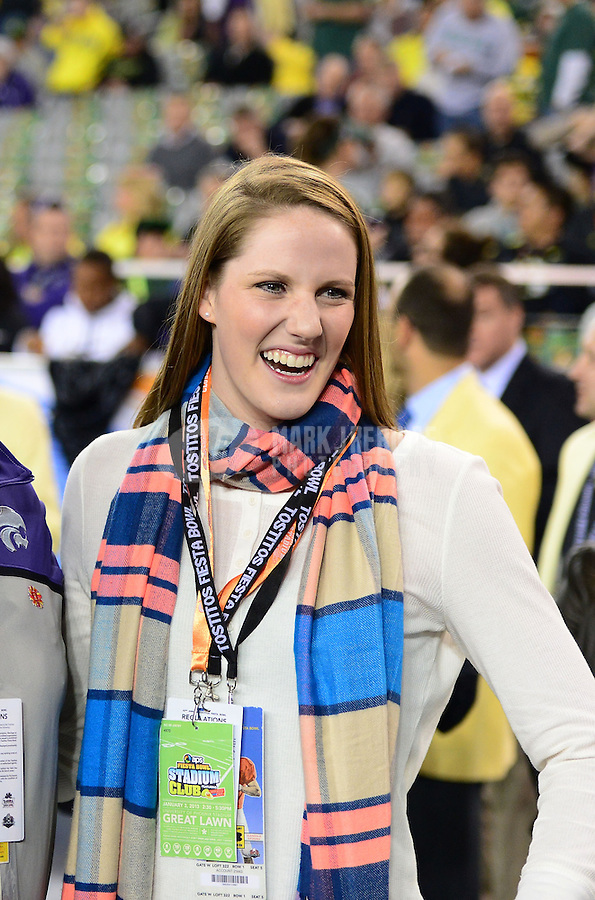 Jan. 3, 2013; Glendale, AZ, USA: Olympic gold medalist swimmer Missy Franklin on the sidelines in the first quarter of the game between the Oregon Ducks against the Kansas State Wildcats during the 2013 Fiesta Bowl at University of Phoenix Stadium. Oregon defeated Kansas State 35-17. Mandatory Credit: Mark J. Rebilas-