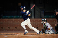 Mobile BayBears Zach Houchins (5) at bat in front of catcher Rodrigo Vigil (1) during a Southern League game against the Jacksonville Jumbo Shrimp on May 7, 2019 at Hank Aaron Stadium in Mobile, Alabama.  Mobile defeated Jacksonville 2-0.  (Mike Janes/Four Seam Images)