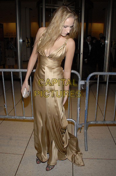 "LEELEE SOBIESKI.The Film Society of Lincoln Center and Fox Searchlight Pictures present ""The Darjeeling Limited"" on opening night of the New York Film Festival at Avery Fisher Hall, New York, New York, USA..September 28th, 2007.full length gold satin dress looking down clutch purse bag .CAP/ADM/BL.©Bill Lyons/AdMedia/Capital Pictures. *** Local Caption ***"