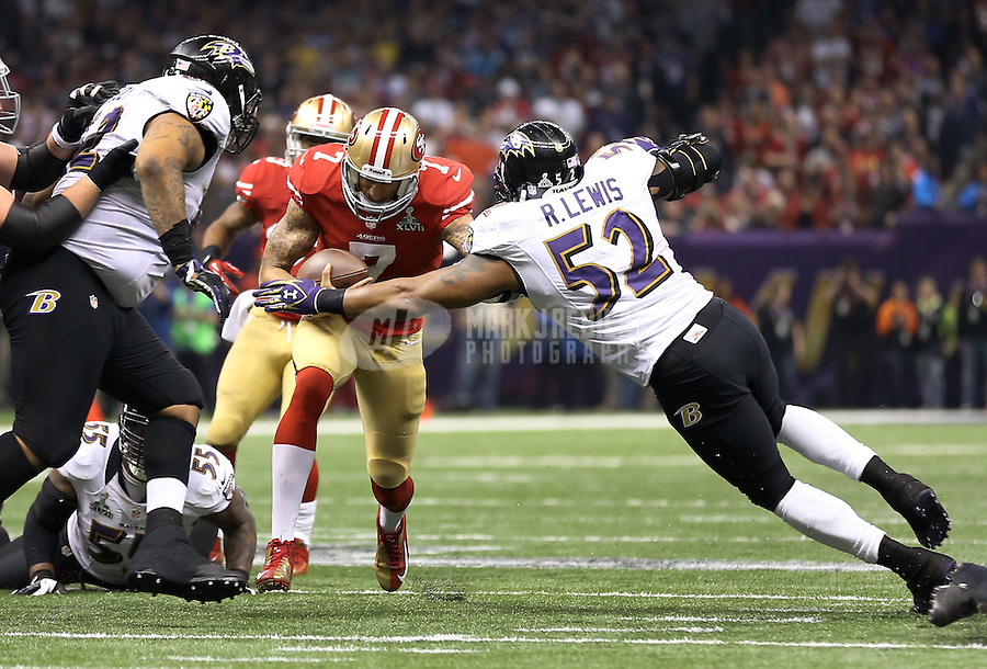 Feb 3, 2013; New Orleans, LA, USA; San Francisco 49ers quarterback Colin Kaepernick (7) is tackled by Baltimore Ravens linebacker Ray Lewis (52) in Super Bowl XLVII at the Mercedes-Benz Superdome. Mandatory Credit: Mark J. Rebilas-