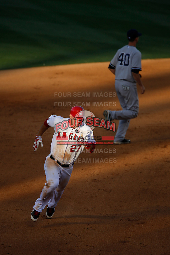 Mike Trout #27 of the Los Angeles Angels runs the bases during a game against the New York Yankees at Angel Stadium on June 15, 2013 in Anaheim, California. (Larry Goren/Four Seam Images)