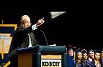 WATERBURY, CT-062117JS14- John E. Theriault, Commissioner of the Waterbury Board of Educations, tosses a paper airplane following his remarks to the graduating class of Kennedy High School Wednesday at Kennedy High School in Waterbury.  Jim Shannon Republican-American