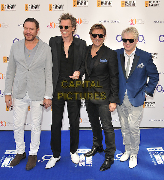 LONDON, ENGLAND - JULY 03: Duran Duran ( Simon Le Bon, John Taylor, Roger Taylor &amp; Nick Rhodes ) attend the Nordoff Robbins O2 Silver Clef Awards 2015, Grosvenor House Hotel, Park Lane, on Friday July 03, 2015 in London, England, UK. <br /> CAP/CAN<br /> &copy;Can Nguyen/Capital Pictures