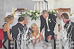 Its official Hilary and Kieran Donaghy sign the registrar at St Finians Church Waterville on Friday.