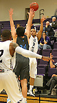 SIOUX FALLS, SD - DECEMBER 5:  Freddie Young #23  from the University of Sioux Falls shoots over Jessie Big Knife #20 from Upper Iowa in the first half of their game Friday night at the Stewart Center.  (Photo by Dave Eggen/inertia)