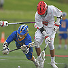 Dylan Pape #3 of West Islip, left, and Drew Martin #14 of Half Hollow Hills East battle for control of a loose ball during a Suffolk County varsity boys lacrosse game at Half Hollow Hills High School East on Tuesday, May 9, 2017. Hills East rallied from an early 6-2 deficit to win 14-10.
