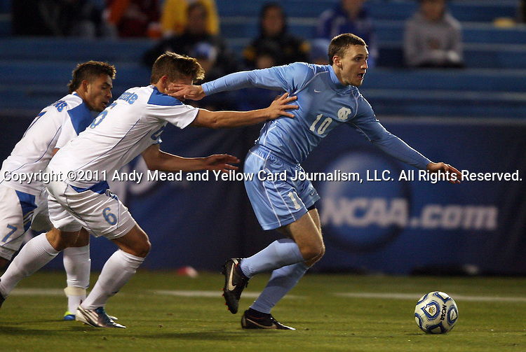 09 December 2011: North Carolina's Billy Schuler (10) pushes off from UCLA's Matt Wiet (6). The University of California Los Angeles Bruins played the University of North Carolina Tar Heels to a 2-2 tie after overtime, with the Tar Heels advancing with a 3-1 win in the penalty kick shootout at Regions Park in Hoover, Alabama in an NCAA Division I Men's Soccer College Cup semifinal game.