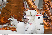 In Earth Orbit - May 16, 2009 -- STS-125 mission specialist John Grunsfeld is about to attach a tether during a May 16, 2009, spacewalk to perform work on the Hubble Space Telescope. This was the third of five planned spacewalks for the mission..Credit: NASA via CNP