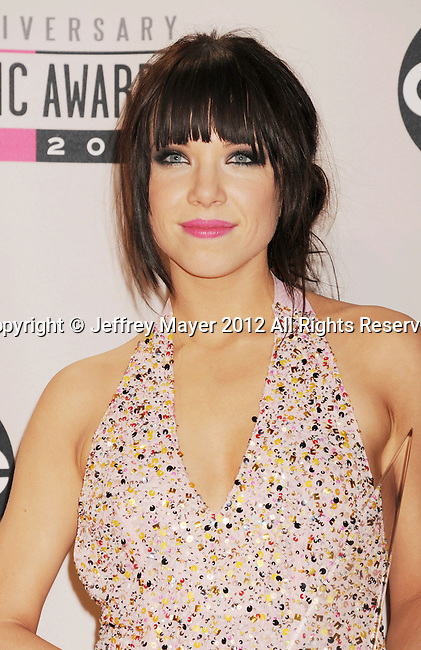 LOS ANGELES, CA - NOVEMBER 18: Carly Rae Jepsen   poses in the press room at the 40th Anniversary American Music Awards held at Nokia Theatre L.A. Live on November 18, 2012 in Los Angeles, California.