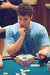 Scott Clements wears two bracelets: one from the WPT Canadien Open & one from the 2006 WSOP.