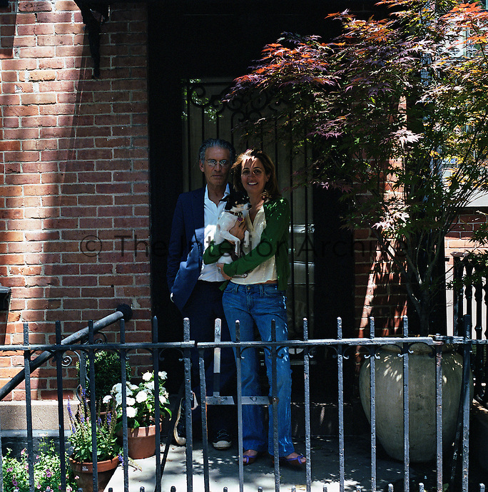 Stylist Sciascia Gambaccini and her husband photographer Wayne Maser stand outside their West Village town house