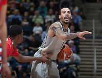 Justin Cobbs of California calls a play during the game against Fresno State at Haas Pavilion in Berkeley, California on December 14th, 2013.  California defeated Fresno State, 67-56.