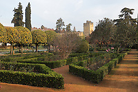 Box hedges and orange trees in the gardens of the Alcazar de los Reyes Cristianos or Palace of the Catholic Kings, rebuilt during the Umayyad Caliphate in the 10th century and used as a royal fortress by the Moors and the Christians, as a base for the Spanish Inquisition, and as a prison, in Cordoba, Andalusia, Southern Spain. The alcazar is a national monument of Spain, and the historic centre of Cordoba is listed as a UNESCO World Heritage Site. Picture by Manuel Cohen