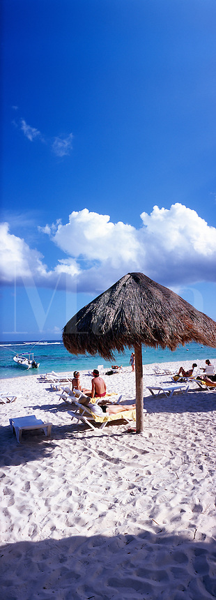 Mexico Quintana Roo Yucatan Peninsula Akumal Mayan Riviera,panorama view of beach and sea with palapa