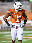 Texas Longhorns linebacker Keenan Robinson (1) warms up before the game between the Oklahoma State Cowboys and the University of Texas in Austin Texas Longhorns at the Daryl K. Royal- Texas Memorial Stadium in Austin, Texas. The Oklahoma State Cowboys defeated the Texas Longhorns 33 to 16.