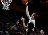 December 29th, 2012: California's David Kravish shoots for the basket during a game Harvard at Haas Pavilion in Berkeley, Ca Harvard defeated California 67 - 62