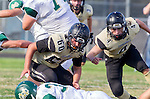 Palos Verdes, CA 10/25/13 - Carlo Merola (Peninsula #60) and Mike Joncich (Peninsula #4) in action during the Mira Costa vs Peninsula varsity football game at Palos Verdes Peninsula High School.