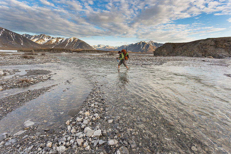 Crossing the Ribdon River. Arctic National Wildlife Refuge, Brooks Range, Arctic Alaska.