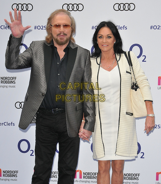 Barry Gibb &amp; Linda Gibb at the Nordoff Robbins O2 Silver Clef Awards 2016, Grosvenor House Hotel, Park Lane, London, England, UK, on Friday 01 July 2016.<br /> CAP/CAN<br /> &copy;CAN/Capital Pictures