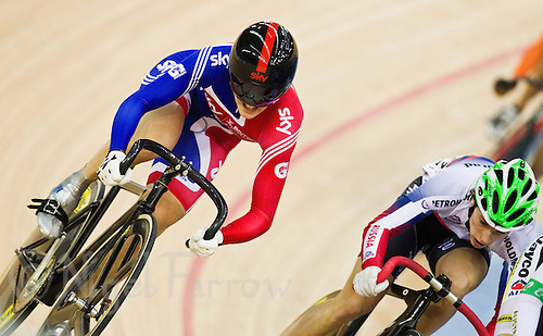 19 FEB 2012 - LONDON, GBR - Great Britain's Victoria Pendleton (GBR) (in blue and red on left) takes the long route to qualification during her first round race of the Women's Keirin at the UCI Track Cycling World Cup, and London Prepares test event for the 2012 Olympic Games, in the Olympic Park Velodrome in Stratford, London, Great Britain (PHOTO (C) 2012 NIGEL FARROW)