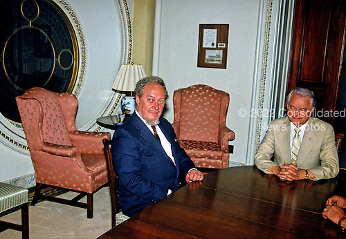Judge Robert H. Bork, United States President Ronald Reagan's nominee for Associate Justice of the U.S. Supreme Court, meets with U.S. Senate Majority Leader Robert C. Byrd (Democrat of West Virginia) in the U.S. Capitol on July 9, 1987.  Bork passed away on December 19, 2012..Credit: Ron Sachs / CNP