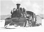 Pilot end, fireman's side view of K-27 #464 idling in the Durango yards in snow.<br /> D&amp;RGW  Durango, CO  Taken by Richardson, Robert W. - 12/17/1951