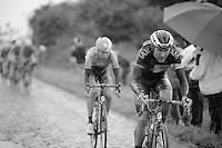 Heinrich Haussler (AUS/IAM) &amp; Jens Keukeleire (BEL/Orica-GreenEDGE) on the cobbles of sector 6: Bers&eacute;e (1400m)<br /> <br /> 2014 Tour de France<br /> stage 5: Ypres/Ieper (BEL) - Arenberg Porte du Hainaut (155km)