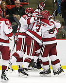 David Valek (Harvard - 22), Michael Del Mauro (Harvard - 13) and teammates celebrate Del Mauro's goal. - The Harvard University Crimson defeated the St. Lawrence University Saints 4-3 on senior night Saturday, February 26, 2011, at Bright Hockey Center in Cambridge, Massachusetts.