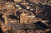 Cusco, Peru. View of the Plaza de Armas including La Compania church and the University entrance.