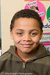 closeup portrait of boy smiling early primary grades vertical