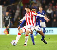 26th November 2019; Cardiff City Stadium, Cardiff, Glamorgan, Wales; English Championship Football, Cardiff City versus Stoke City; Lee Gregory of Stoke City holds back the challenge from Curtis Nelson of Cardiff City - Strictly Editorial Use Only. No use with unauthorized audio, video, data, fixture lists, club/league logos or 'live' services. Online in-match use limited to 120 images, no video emulation. No use in betting, games or single club/league/player publications