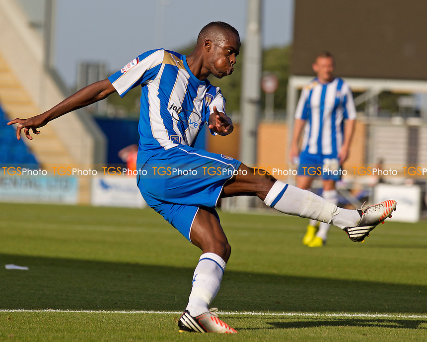 Gavin Massey of Colchester United with a fierce strike at goal - Colchester United vs Doncaster Rovers - NPower League One Football at the Weston Homes Community Stadium, Colchester, Essex - 15/09/12 - MANDATORY CREDIT: Ray Lawrence/TGSPHOTO - Self billing applies where appropriate - 0845 094 6026 - contact@tgsphoto.co.uk - NO UNPAID USE.