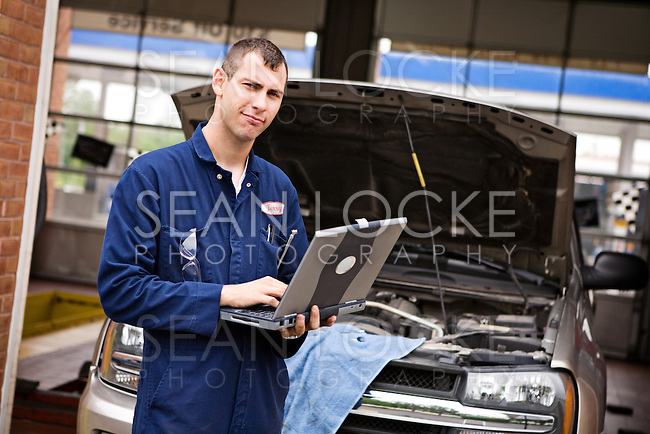 Extensive series of a woman who has taken her car to the auto service garage, and the mechanic who works on her truck.