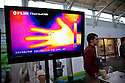 FLIR ThermaCAM shows the heat detected from a person's hand held in front of its sensor. This technology is used to help evaluate insulation needs in buildings. West Coast Green is the nation's largest conference and expo dedicated to green innovation, building, design and technology. The conference featured over 300 exhibitors, 125 speakers, and 80 education and networking sessions. Fort Mason, San Francisco, California, USA. Photo taken October 2, 2009.