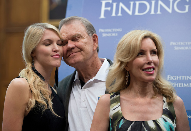 UNITED STATES - MAY 15: Grammy winning musician Glen Campbell, who was recently diagnosed with Alzheimer's, hugs his daughter Ashley, left, and wife Kim during the news conference held by Rep. Edward Markey, D-Mass., co-chair of the Congressional Taskforce on Alzheimer's Disease to urge action on Alzheimer's disease on Tuesday, May 15, 2012. (Photo By Bill Clark/CQ Roll Call)
