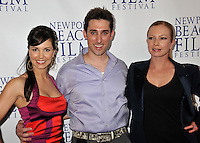 "AMIE BARSKY, PAUL J. ALESSI, producer/actor & TRACI LORDS.""Knuckle Draggers"" Premiere at the 2009 Newport Beach Film Festival held at Edwards Cinemas, Newport Beach, CA, USA..April 27th, 2009.half length black purple shirt jacket tracey tracy blue silk satin red dress amy aimee.CAP/ADM/BP.©Byron Purvis/AdMedia/Capital Pictures."