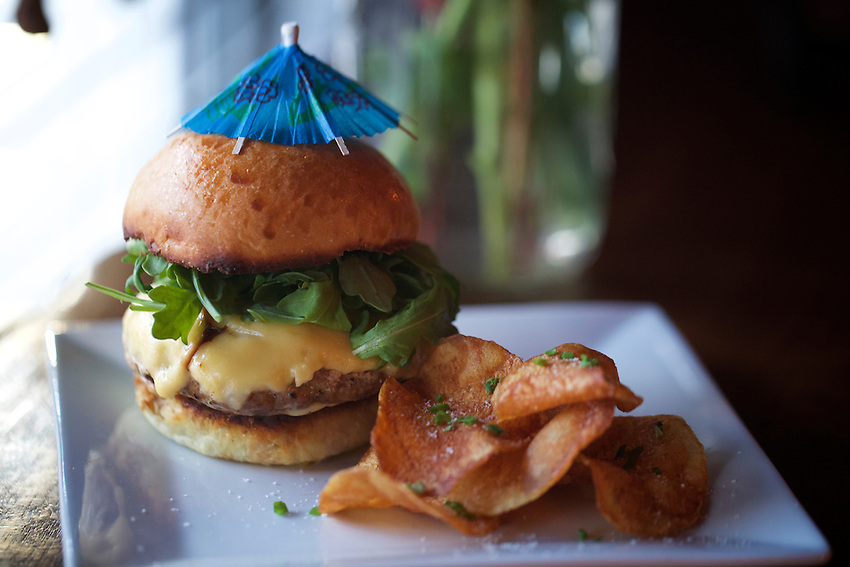 Jersey City, NJ - April 27, 2016: The Duck Burger at The Archer, a cocktail bar serving a menu of game meat-centered dishes on Newark Avenue in Jersey City.<br /> <br /> CREDIT: Clay Williams for Gothamist<br /> <br /> &copy; Clay Williams / claywilliamsphoto.com