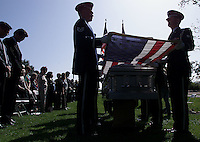SANTA BARBARA.  USAF Honor Guard prepare to fold american flag for presentation to sister of Lt. Col. Ross Fobair, at ceremony, Sunday in Elings Park in Santa Barbara.   Betty McDermott (left/center) watches  as her brothers coffin  arrives.  Several hundred people  attend a memorial service for Lt. Col. Ross Fobair, an American airman who was shot down over Vietnam in 1964 and officially unaccounted for until late last year