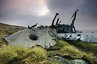 Pictured: The wreckage of the Wellington Bomber MF509 in the Brecon Beacons, Wales, UK. <br /> Re: The nephew of a World War II airman whose plane crashed into a Welsh mountain has climbed the peak to pay tribute to the uncle he never met.<br /> Dr Peter Par&eacute;, 74, travelled from his home in Vancouver, Canada, to read a poem at the desolate spot where his uncle Bill Allison was killed.<br /> Flying officer Allison, 28, was one of the six crew of a Wellington Bomber that crashed on a training flight in November 1944.<br /> The plane wreckage is still scattered over Carreg Goch in the Brecon Beacons where hundreds of young airmen learned to prepare for bombing missions.<br /> Dr Par&eacute; said: &ldquo;I wanted to make this pilgrimage even though I was a baby when he died and never met Bill Allison.<br /> &ldquo;We only found out about the crash site recently and it is remarkable that so much of the plane is still here.&rdquo;<br /> Flying officer Allison was the oldest on board when the plane&rsquo;s starboard engine developed a fault during a low-flying exercise.<br /> For years local people have honoured the brave airmen by flying a Canadian flag at the scene - replacing it every time it gets ripped by strong winds.<br /> Dr Par&eacute;, retired Professor of Medicine at the University of British Columbia, said: &ldquo;It was very moving to see the Maple Leaf flying where my uncle died all those years ago.<br /> &ldquo;It brought a tear to my eye as I read the poem I wrote in his honour.&rdquo;