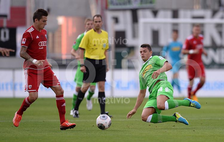 FUSSBALL  1. Bundesliga   2013/2014   Testspiel  FC Ingolstadt 04 - Borussia Moenchengladbach    13.07.2013 Granit Xhaka (re, Borussia Moenchengladbach) gegen Christoph Knasmueller (FC Ingolstadt 04)