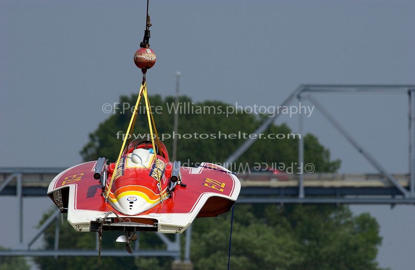 "2003 Madison Regatta, 5-6 July 2003, Madison, IN USA                                .The 1970 Ron Jones cabover hydroplane ""Chuck Wagon"" E-22 is lifted into the water..F. Peirce Williams .photography.P.O.Box 455  Eaton, OH 45320 USA.p: 317.358.7326  fpwp@mac.com"