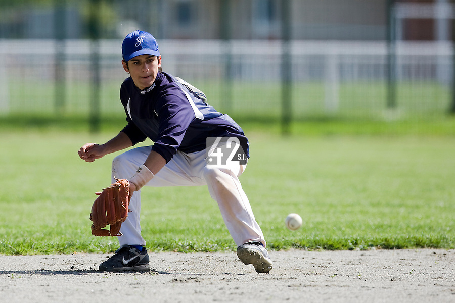 30 April 2008: Maxime Lefevre of France takes infield practice  during the first of seven 2008 MLB European Academy Try-out Sessions throughout Europe, at Stade Kandy Nelson Ball Park, in Toulouse, France. Try-out sessions are run by members of the Major League Baseball Scouting Bureau with assistance from MLBI staff.