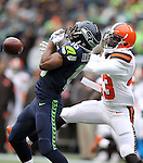 Seattle Seahawks wide receiver Jemaine Kearse (15) has the ball knocked away by Cleveland Browns defensive back Charles Gaines (43) at CenturyLink Field in Seattle, Washington on December 20, 2015. The Seahawks clinched their fourth straight playoff berth in four seasons by beating the Browns 30-13.  ©2015. Jim Bryant Photo. All Rights Reserved.