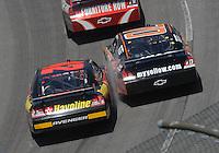 May 6, 2007; Richmond, VA, USA; Nascar Nextel Cup Series drivers Juan Pablo Montoya (42) and Johnny Sauter (70) make contact during the Jim Stewart 400 at Richmond International Raceway. Mandatory Credit: Mark J. Rebilas