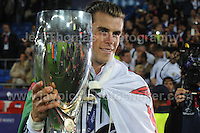Cardiff City Stadium, Cardiff, South Wales - Tuesday 12th Aug 2014 - UEFA Super Cup Final - Real Madrid v Sevilla - <br /> <br /> Real Madrid&rsquo;s Gareth Bale with the UEFA Super Cup 2014 and wears his National flag with pride. <br /> <br /> <br /> <br /> <br /> Photo by Jeff Thomas/Jeff Thomas Photography
