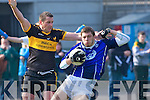 David Moran KOR is tackled by James Cahillane Dr Crokes in the Divison 1 league final in Killarney on Sunday