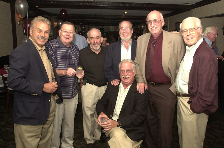 Group shot taken at John Cornell's retirement party.  Left to right: Joe Dombroski, Bob Lucket, Stan Wolfson, Don Norkett, Dick Kraus and Tom Maguire- with Cornell kneeling in center. Phot by Jim Peppler.