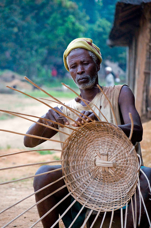 A man makes a basket in the village of Lalehun